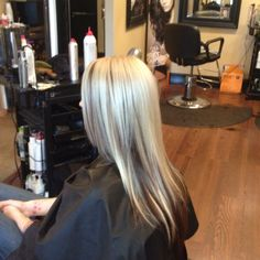 Chocolate brown peekaboo color with beautiful blonde @ the color bar