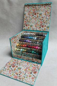 bobbin storage - thread - needlework - sewing - seamstress floss - ribbon - sewing room - storage - box - lovely - found pinned as boite à canettes 10 x 10 cardboard box covered with fabric.Idea for ear ring jewelry box.Discover recipes, home ideas Bobbin Storage, Sewing Room Storage, Sewing Room Organization, Sewing Rooms, Craft Storage, Paper Storage, Thread Storage, Fabric Storage, Storage Boxes
