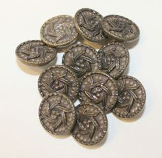 11 Vintage brass buttons with dots surrounding leaf and berry design. $12.00 USD