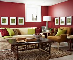 A strong color scheme is the foundation of this room's design. Deep crimson and olive green show that opposite colors do attract. The repetition of green squares on the geometric wall art and throw pillows adds unique visual interest.