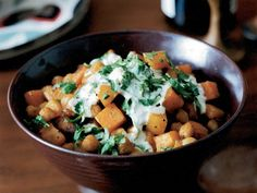 Curry-Roasted Butternut Squash and Chickpeas | This Indian twist on the traditional Thanksgiving dish of roasted butternut squash is supereasy: After tossing the squash and chickpeas with curry and...