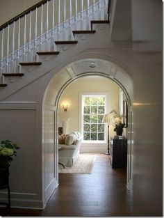 Arched passageway under stairs