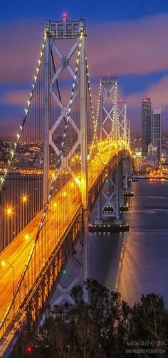 'Yellow Brick Road' Bay Bridge at night, San Francisco. The Bay bridge connects the Berkley area and the south with the city of San Francisco. Places To Travel, Places To See, Places Around The World, Around The Worlds, Yellow Brick Road, San Fransisco, Wonders Of The World, Beautiful Places, Photos