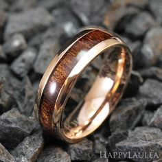 Stainless Steel Ring with Koa Wood Inlay (6mm width, Rose gold IP, Barrel style) Made with top grade 316L Stainless Steel, this ring features Koa