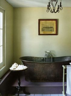 violet floor pistachio green walls in bathroom...zinc tub...by marianne evennou