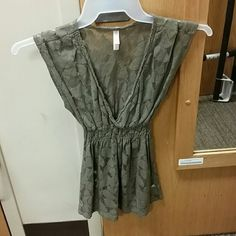 Olive green medium shirt Medium see through olive green shirt with floral imprint, scrunched under the breasts with a very deep v cut cleavage Xhilaration Tops Blouses
