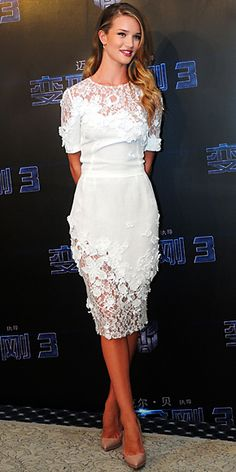 Rosie Huntington-Whiteley in a lace Dolce & Gabbana cocktail dress and leather stilettos