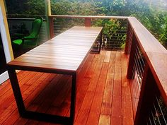 Custom Outdoor Table with Black Powdercoat Frame and Spotted Gum Timbers. By Outdoor Table Creations