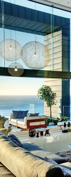 Even though I don't want to love on a beach, I love the spherical light fixtures and the panoramic windows.