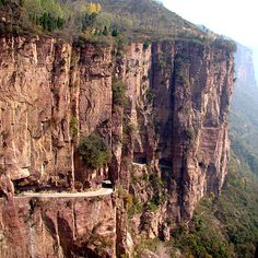 From 1972 to 1977, a handful of villagers from Guoliang, in South Central, China, dug and hand-chiseled a terrifyingly narrow, twisting road through the cliffs to the outside world. Death-Defying Drive. Via T+L (www.travelandleisure.com).
