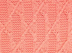The Heraldic Pattern uses twisted stitches to give it a cabled look, but no cable needle necessary.  This stitch is found in the Cables & Twisted Stitches category.