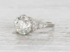 Vintage Edwardian engagement ring made in platinum and centered with a carat GIA certified old European cut diamond with M color and clarity. Circa This ring is a stunner! The center di Diamonds And Gold, European Cut Diamonds, Deco Engagement Ring, Antique Engagement Rings, Bijoux Art Deco, Ring Verlobung, Vintage Rings, Vintage Art, Vintage Diamond Rings
