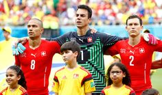 Gokhan Inler, Diego Benaglio and Stephan Lichtsteiner of Switzerland look on prior to the 2014 FIFA World Cup Brazil Group E match between Honduras and Switzerland at Arena Amazonia on June 25, 2014 in Manaus, Brazil.