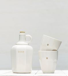 Porcelain Whiskey Decanter & Tumbler Set in Home by Redraven Studios on Scoutmob Shoppe. This English porcelain whiskey decanter and tumbler set includes 14k gold luster details and a simple cork top.