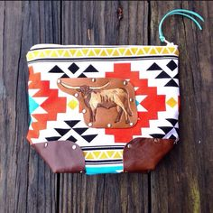 Canvas and Leather Longhorn Cosmetic Bag by 76andRiveted on Etsy https://www.etsy.com/listing/285898743/canvas-and-leather-longhorn-cosmetic-bag