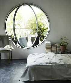 This circular window by Paul Archer designs has a fururistic quality. I would love to have this window in our Florida home. Enjoy RUSHWORLD boards, EYE CANDY ARCHITECTURAL MASTERPIECES, FURNISHINGS AND FIXTURES FOR EVERY BUDGET and ART A QUIRKY SPOT TO FIND YOURSELF. Follow RUSHWORLD on Pinterest! New content daily, always something you'll love!
