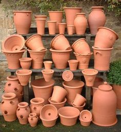 Hand made clay flower pots. Terracotta, the most simple and traditional forms and shapes, decor. Terracotta Flower Pots, Clay Flower Pots, Clay Pots, Garden Seeds, Garden Pots, Small Garden Landscape, Plant Shelves, Potted Plants, Orange