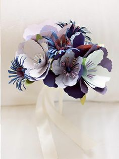Very cool bouquet    Carry an unexpected bouquet    For a twist on a traditional wedding bouquet, swap out the traditional floral cluster for a dramatic bunch of paper or fabric flowers.