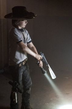 Chandler Riggs. Adorable!!!!!! Love him!! Best character! Willing to give up his life for his dad, but he wasn't a zombie....