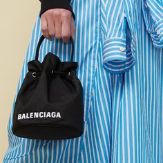 """Lane Crawford on Instagram: """"This micro @balenciaga holds a bucket full of style - the perfect complement to your off-duty wardrobe.   Shop Balenciaga from the link…"""""""