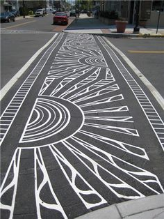 This street looks so rad. I think it would be so fun to do this in my neighborhood. What a fun stamped idea.