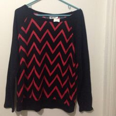 Beautiful Long Sleeve with Design Shirt Beautiful Long Sleeve with Coral Zig Zag Design. Very Soft with Black Base, Hem Line and Sleeves. Hot Ginger Tops Tees - Long Sleeve