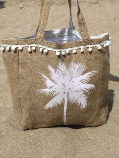 Items similar to POMPOM HESSIAN BEACHBAG on Etsy Hessian, Burlap, My Bags, Purses And Bags, Best Beach Bag, Coffee Bean Bags, Diy Sac, Jute Bags, Boho Bags