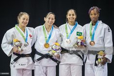July 13 - Judo Women's - 63 kg.  Silver medalist Stephanie Tremblay of Canada, Gold medalist Estefania Garcia of Ecuador, Bronze medalists Mariana Silva of Brazil and Maylin Del Toro of Cuba pose for a photo with their medals following the medal ceremony for the women's judo 63kg class at the 2015 Pan American Games in Toronto, Canada on July 13, 2015. AFP PHOTO/GEOFF ROBINS