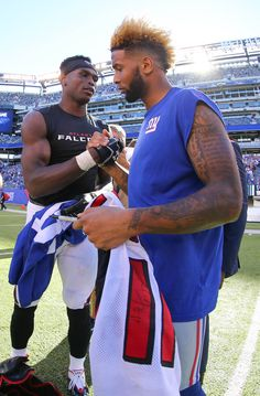 Sep 20, 2015; East Rutherford, NJ, USA; Atlanta Falcons wide receiver Julio Jones (11) and New York Giants wide receiver Odell Beckham Jr. (13) exchange jerseys after their game at MetLife Stadium. The Falcons defeated the Giants 24-20. (2115×3223)