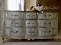 I'm kind of digging this dresser!  Girl in Pink: Mystery Paint Finish for a Pretty Provincial Dresser