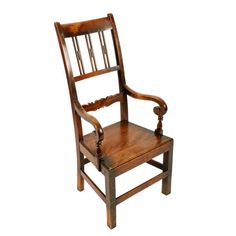 """Scottish Birch Country Chair   A mid 19th century Scottish birch wood high back arm chair.  Very similar """"Glasgow Pattern"""" arm chairs can be seen in the """"Scottish Vernacular Furniture"""" book by Bernard Cotton, pages 178-184.  The arm chair has a much higher back than normal with vertical splats and a shaped cross rail.  The joints are pegged and the arm supports have a single handmade screw to each side.  The solid birch seat and cross rails that make this a strong chair.  The chair is an… Patterned Armchair, Antique Chairs, Arm Chairs, Rocking Chair, Glasgow, Country Style, Birch, 19th Century, Victorian"""
