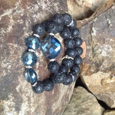 This listing is for a 2 bracelet set. These are 12mm black lava gemstone beads with gorgeous blue chinese crystals. They are accented with rhinestone rondelle spacers. These can be worn with jeans or dressed up for evening.