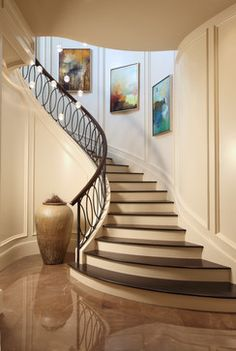 7 Stylish Staircases - OMG Lifestyle Blog - Circular Staircase with Iron Rail - http://goo.gl/ghaPuh