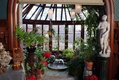 Mark Twain conservatory ~ The library opens up to a conservatory in Mark Twain's home. Interior design by Louis Comfort Tiffany and Associated American Artists.