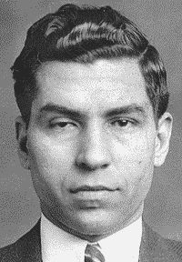 "Charlie ""Lucky"" Luciano (pronounced ""loo-tch-a-noh"") (born Salvatore Lucania; November 24, 1897 – January 26, 1962) was an Italian mobster born in Sicily. Luciano is considered the father of modern organized crime in the United States for splitting New York City into five different Mafia crime families and the establishment of the first commission. He was the first official boss of the modern Genovese crime family."