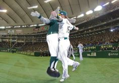 Stomper and Josh Reddick chest bump in Japan