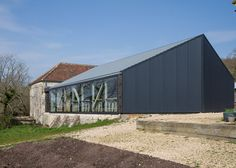 A cookery school is housed behind the facade of this shed, recently completed by Satellite Architects at the headquarters of TV programme River Cottage River Cottage, School Architecture, Amazing Architecture, Modern Architecture, Wooden Island, Steel Barns, Long House, Contemporary Building, Interior Design Studio