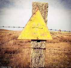 Radiation danger signs are used to warn people as they approach the uranium mines...uranium mine in Kazakhstan. #spy #plot