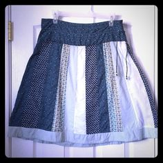 """American Eagle Patchwork Midi Skirt This cute skirt is very comfortable to wear as it is made of very soft cotton. It has a side zipper with a string for closure. The skirt is lined with light blue fabric. Length of the skirt is 23"""". Looks great with a tank top or T-shirt! American Eagle Outfitters Skirts Midi"""