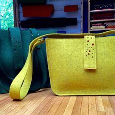 Working on finishing touches to another large felt bag, this one in deep forest green and dark grey.   And now also the new and cute mini version - Little Mustard Seed Yellow Purse! Beautiful fall colors paired with dark grey wool felt.