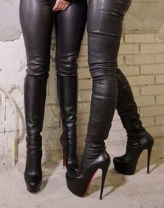 Girls in sexy leather pants and high heel thigh boots