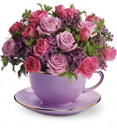 Teleflora's Cup of Roses Bouquet : The cool beauty of this distinctive gift will soothe a family member's soul.