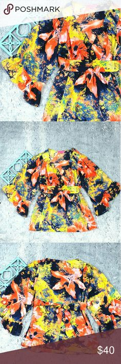 "Betsey Johnson Bright Floral Ruffle Boho Top ITEM FEATURES: Brand: Betsey Johnson Size: S (See Measurements below to insure proper fit.)  Details: V-neck, wide ruffle sleeves, tie back Material: 100% Polyester Condition: Excellent, no flaws  ITEM MEASUREMENTS: Bust: 34"" Length: 27"" Sleeve: 17"" *Measurements taken with items laying flat.  Please keep in mind that colors may vary slightly due to monitor/phone displays Betsey Johnson Tops Blouses"