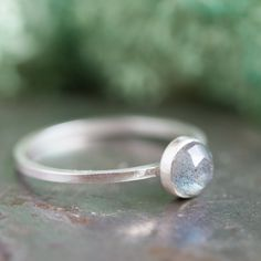 This silver ring is made with beautiful labradorite faceted cabochon. It is a simple and delicate piece, which will become a refined addition to your collection. You may wear this beautiful ring alone