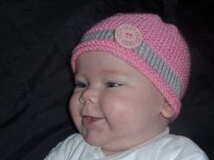 Hand Knitted Pink and silver hat with an by FunkyTraditionalKnit, £6.50
