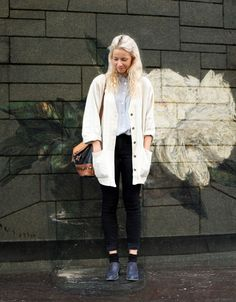 Black skinny pants, blue button down and casual long cardigan.