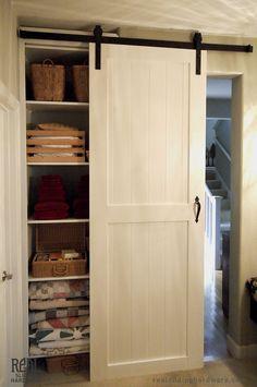 White closet sliding barn doors.
