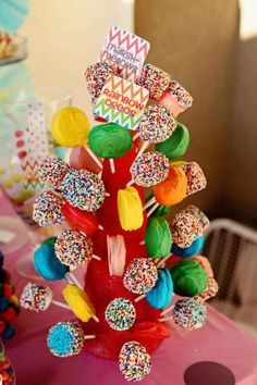 marshmallows + white chocolate + sprinkles on a popsicle stick
