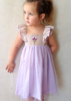 French Lavender smocked dress... So sweet. Pre-ordering now:   www.welldressedwolf.com/pages/pre-orders