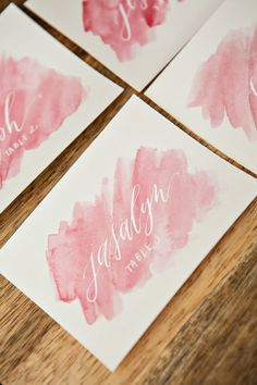 Pink watercolor escort cards with handwritten white calligraphy! Calligraphy Cards, Wedding Calligraphy, Calligraphy Markers, Gold Calligraphy, Beautiful Calligraphy, Wedding Stationary, Wedding Invitations, Watercolor Wedding, Pink Watercolor